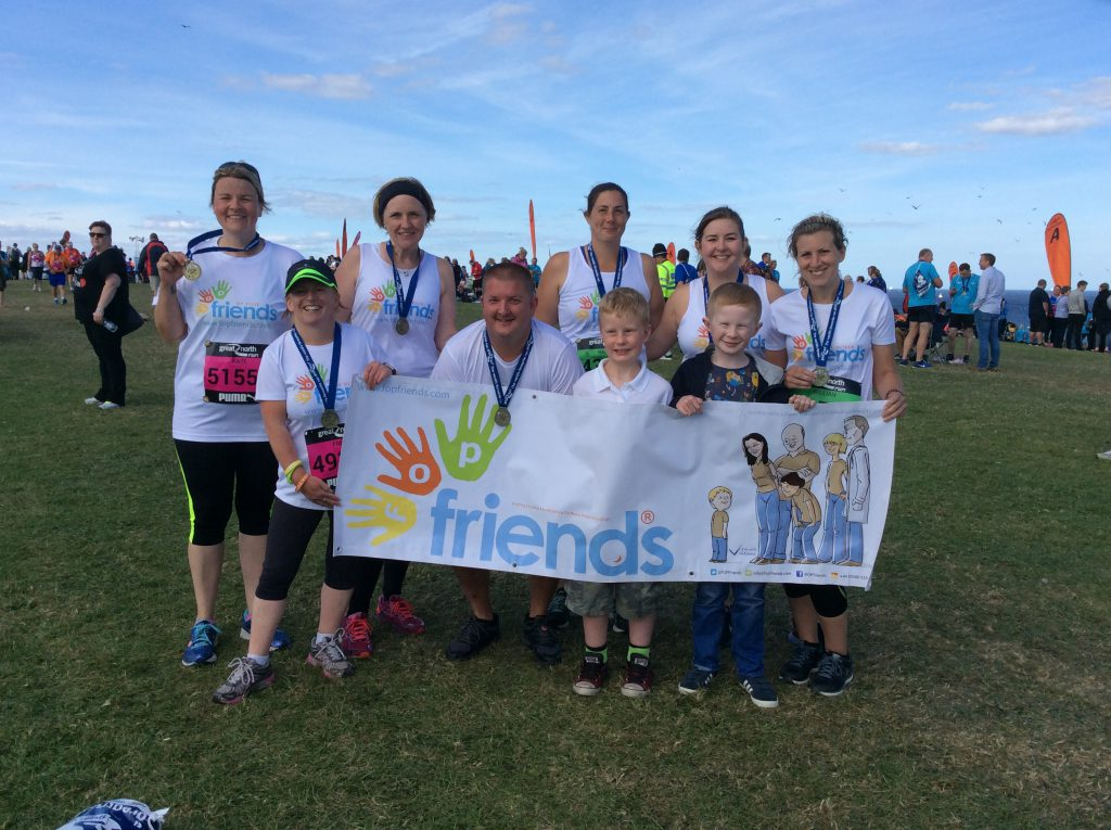 FOP Friends runners with medals